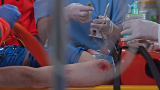 emergency team saving a female car crash victim - orthopedic equipment stock videos & royalty-free footage
