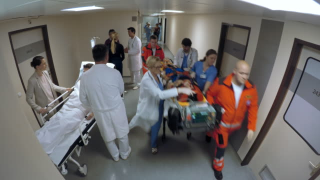 POV Emergency team transporting a patient on the stretcher to the ER