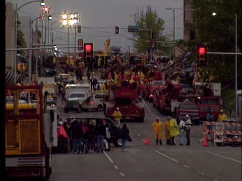 emergency vehicles crowd oklahoma city streets following the deadly federal building bombing. - oklahoma city bombing stock videos & royalty-free footage