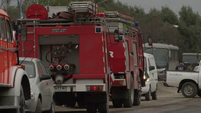 ensenada, chile - april 26, 2015: emergency vehicles parked at side of road - 戦隊点の映像素材/bロール
