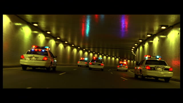 DS Emergency vehicles with flashing lights driving through a tunnel on Interstate 395 / Washington, D.C., United States