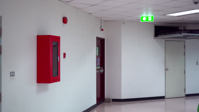 emergency walking to fire escape door - exit sign stock videos & royalty-free footage