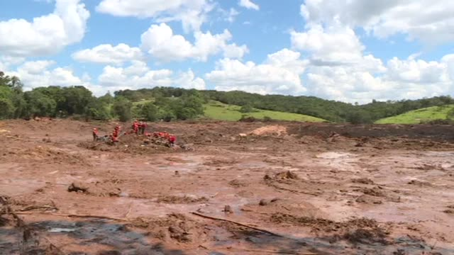 emergency workers in brazil continue searching through the disaster area after a tsunami of mineral laced mud broke through a dam at an iron ore mine... - dam stock videos & royalty-free footage