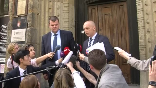 emerging from a budapest courthouse the lawyer for the viking sigyn captain yuriy c speaks to the press about his client's sentiments in the... - legal occupation stock videos and b-roll footage
