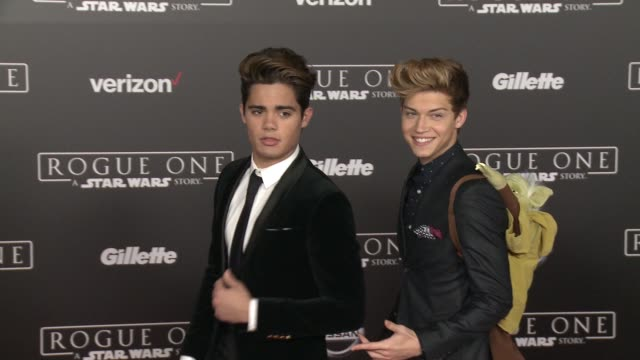 Emery Kelly and Ricky Garcia at Rogue One A Star Wars Story World Premiere at the Pantages Theatre on December 10 2016 in Hollywood California