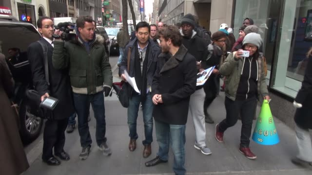 emile hirsch signs autographs for fans while walking to his car outside the today show in rockefeller center in new york city celebrity sightings in... - 有名人のサイン点の映像素材/bロール