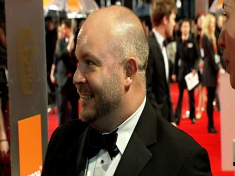 emile sherman, iain canning and gareth unwin at the orange british academy film awards 2011 at london england. - ブランド名点の映像素材/bロール