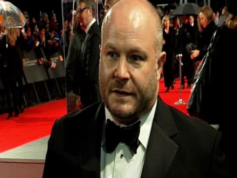emile sherman, iain canning and gareth unwin at the orange british academy film awards 2011 at london england. - ブランド名点の映像素材/bロール