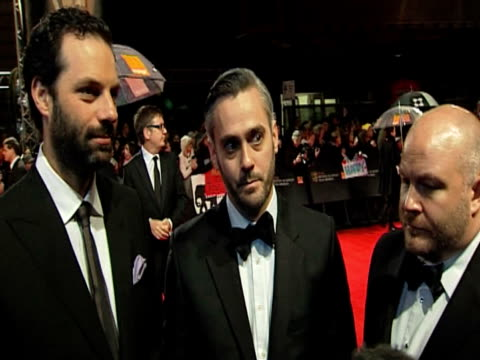 emile sherman, iain canning and gareth unwin on the bafta's and more at the orange british academy film awards 2011 at london england. - ブランド名点の映像素材/bロール