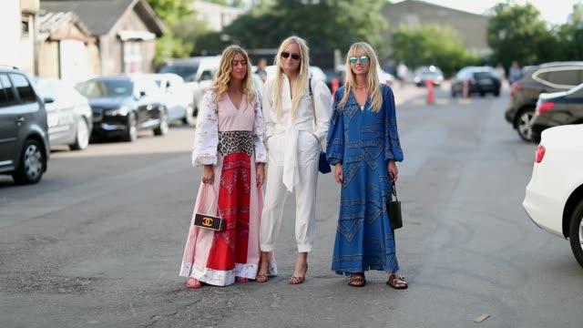 Emili Sindlev Thora Valdimars Jeannette Madsen wearing dress are seen outside Ganni during the Copenhagen Fashion Week Spring/Summer 2019 on August 9...