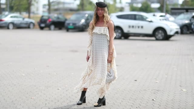 stockvideo's en b-roll-footage met emili sindlev wearing dress with dots print black hat with net is seen outside holzweiler during the copenhagen fashion week spring/summer 2019 on... - jurk