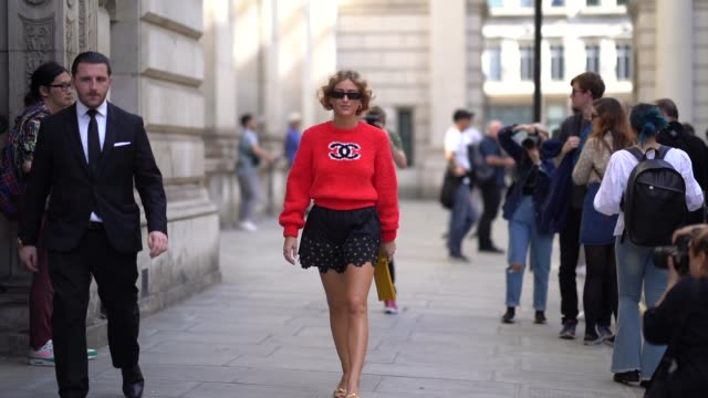 emili sindlev wears a red chanel logo wool pullover black quilted shorts with printed features a yellow rectangular clutch golden shoes sunglasses... - shorts stock videos & royalty-free footage