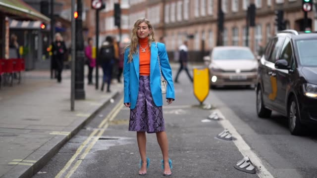 emili sindlev wears an orange turtleneck wool pullover a blue oversized blazer jacket a purple snake print leather skirt a chanel logo necklace... - orange stock videos & royalty-free footage