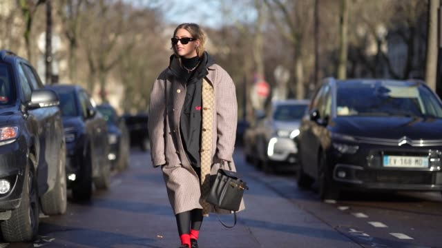 emili sindlev wears sunglasses a supreme jacket with a hood a gucci long oversized coat with houndstooth patterns and printed logos on the inner... - pullover stock-videos und b-roll-filmmaterial