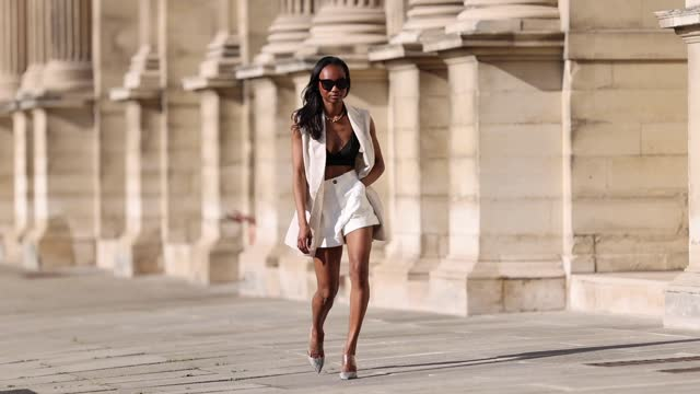 emilie joseph @in_fashionwetrust wears a beige linen double breasted vest, a gold plated chunky necklace from merbabe, gray pointy python printed... - satin stock videos & royalty-free footage