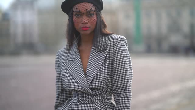 emilie joseph wears a black beret hat from galeries lafayette, a black mesh lace veil, a black and white houndstooth pattern printed oversized double... - tights stock videos & royalty-free footage