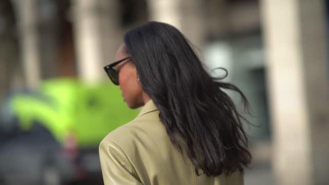 emilie joseph wears sunglasses, a beige faux-leather oversized blazer jacket from mango, on february 11, 2021 in paris, france. - beige stock videos & royalty-free footage
