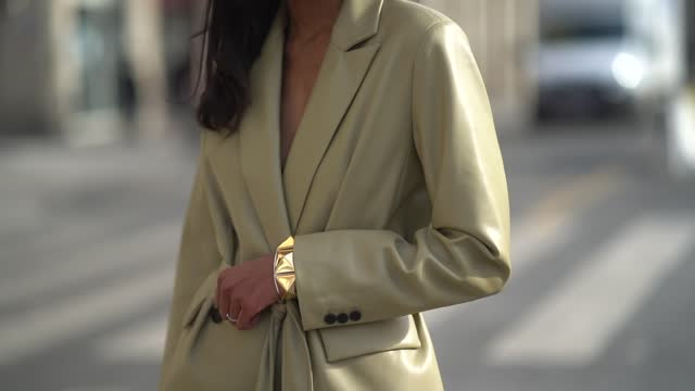 emilie joseph wears sunglasses, a beige faux-leather oversized blazer jacket with integrated belt from mango, flared pants from mango, high heels... - beige stock videos & royalty-free footage