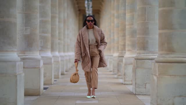 emilie joseph wears sunglasses, a white wool woven pullover from asos, a pale brown beige long puffer padded coat/jacket from free people, beige... - eyewear stock videos & royalty-free footage