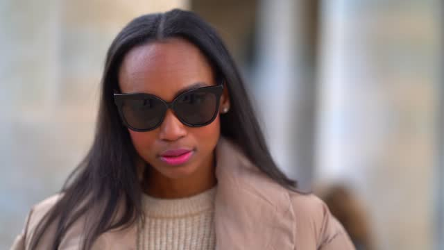 emilie joseph wears sunglasses, a white wool woven pullover from asos, a pale brown beige long puffer padded coat/jacket from free people, beige... - softness stock videos & royalty-free footage