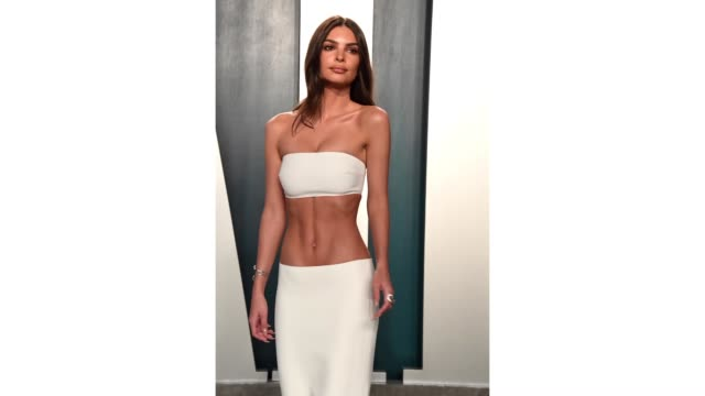 emily ratajkowski attends the 2020 vanity fair oscar party hosted by radhika jones at wallis annenberg center for the performing arts on february 09,... - vanity fair oscar party stock videos & royalty-free footage