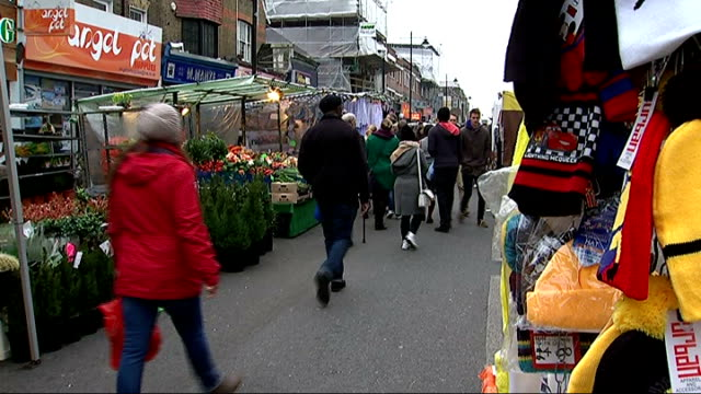 emily thornberry resignation / rochester and strood byelection chapel market reporter to camera/ various shots of shoppers and market stalls in... - chapel stock videos & royalty-free footage