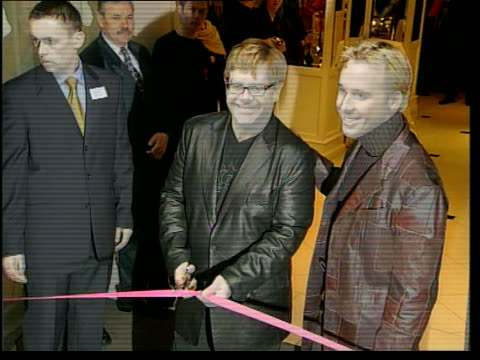 Eminem lyrics row LIB London GVs Sir Elton John cutting ribbon to open shop selling his clothes for aids charity with boyfriend David Furnish