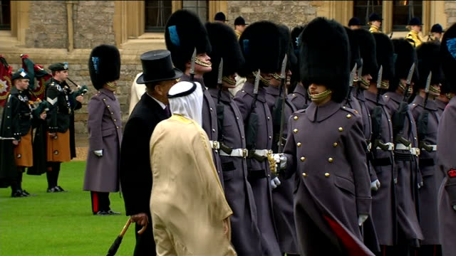 Arrival at Windsor Castle More of Emir inspecting guards and along with Prince Philip to join Queen and Prince Charles on state / Kuwaiti delegation...