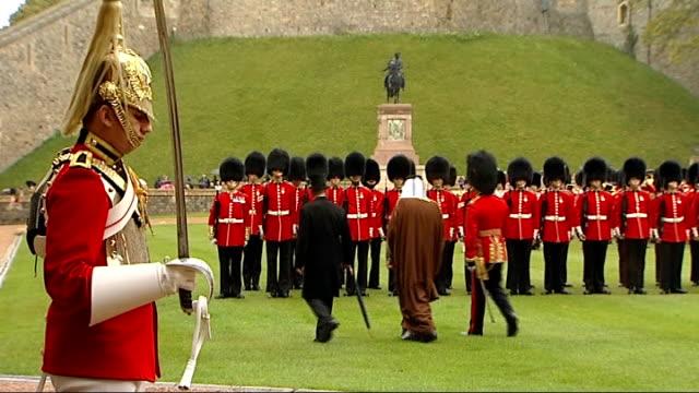 emir of qatar meets queen at windsor castle emir of qatar sheikh hamad bin khalifa althani on steps to castle as coldstream guards perform ceremonial... - カタール点の映像素材/bロール