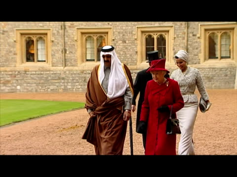 emir of the state of qatar, prince philip, duke of edinburgh, queen and sheikha mozah walk across the quadrangle of windsor castle. qatar state visit... - peerage title stock videos & royalty-free footage