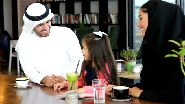 emirati family at cafe - dish dash stock videos & royalty-free footage