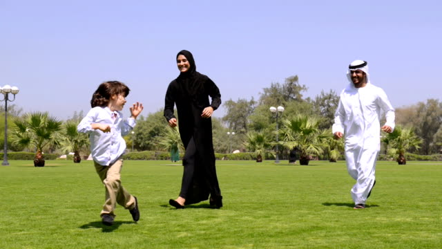 panning: emirati family at the park - middle eastern ethnicity stock videos & royalty-free footage