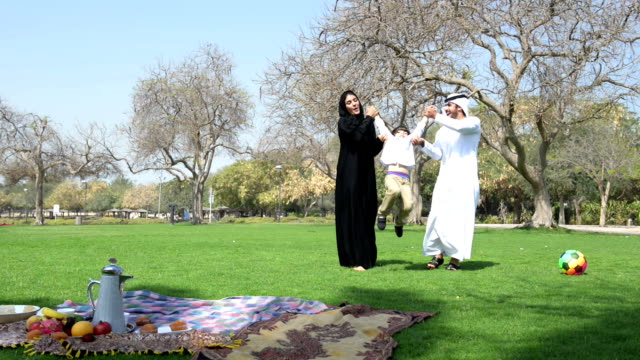 emirati family having fun at picnic - middle eastern culture stock videos & royalty-free footage