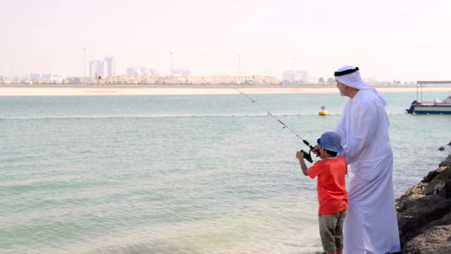 emirati grandfather and little boy at fishing - grandfather stock videos & royalty-free footage