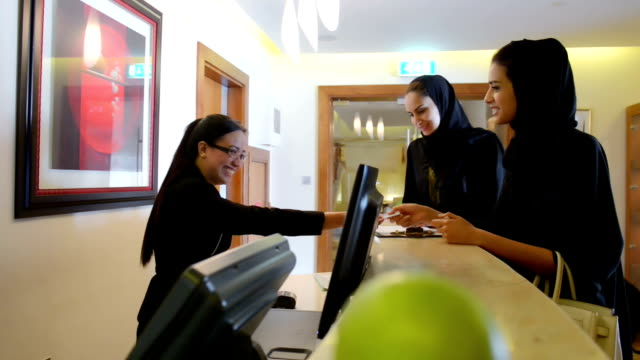 emirati women paying via credit card - commercial activity stock videos and b-roll footage