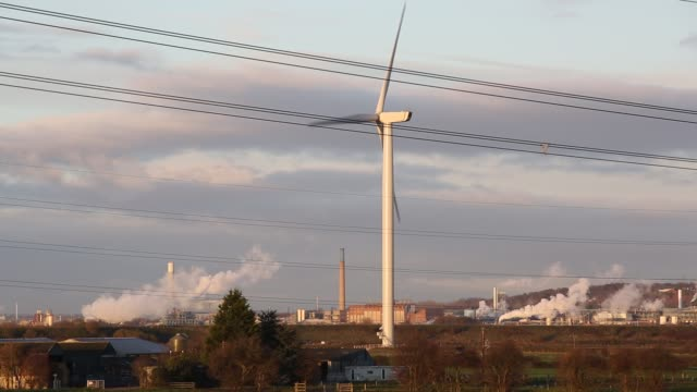emissions from a chemical plant at runcorn with a wind turbine, cheshire, uk. - chemical stock videos & royalty-free footage