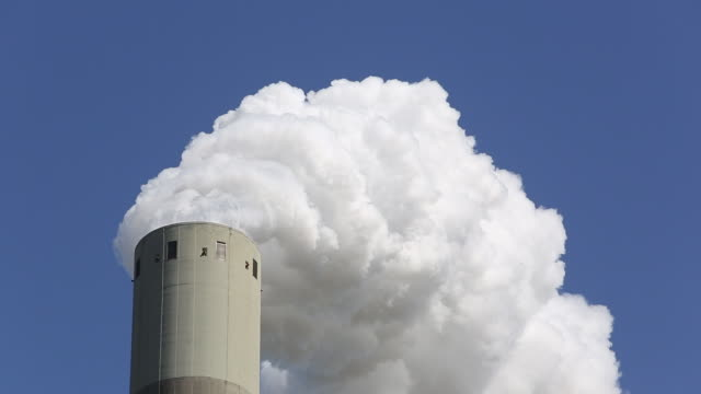 emissions from a coal fired power plant in amsterdam, holland. - coal fired power station stock videos & royalty-free footage