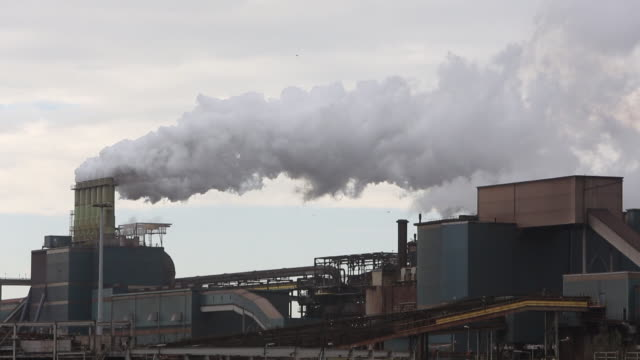 emissions from the tata steel works in ijmuiden near amsterdam, netherlands - olanda settentrionale video stock e b–roll