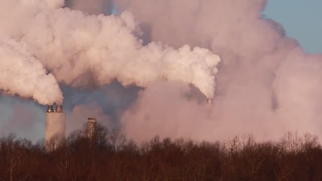 emissions pour from smoke stacks on a cold winter morning at the indianapolis power and light owned coal burning power plant in petersburg indiana... - fossil fuel stock videos & royalty-free footage