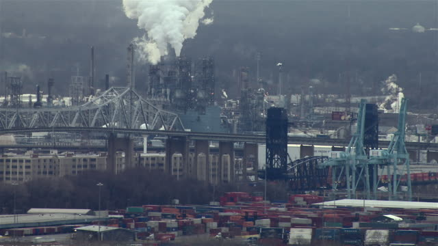 Emissions spew from smokestacks at the Bayway Refinery in the industrial area of Linden, New Jersey.