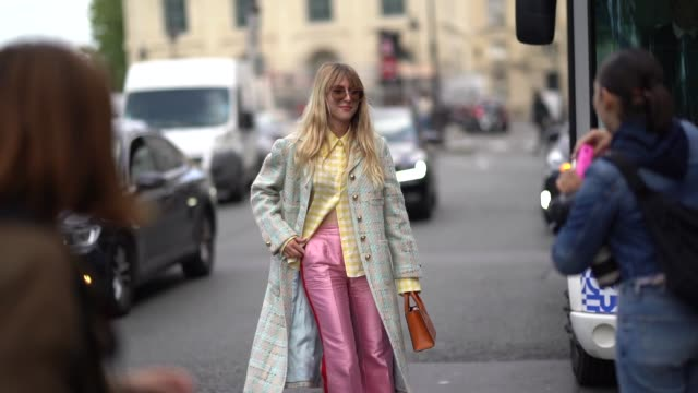 emma bonneaud wears sunglasses a yellow and white checkered shirt a beige and light turquoise blue tweed coat with brass buttons lustrous pink flare... - pink shirt stock videos and b-roll footage