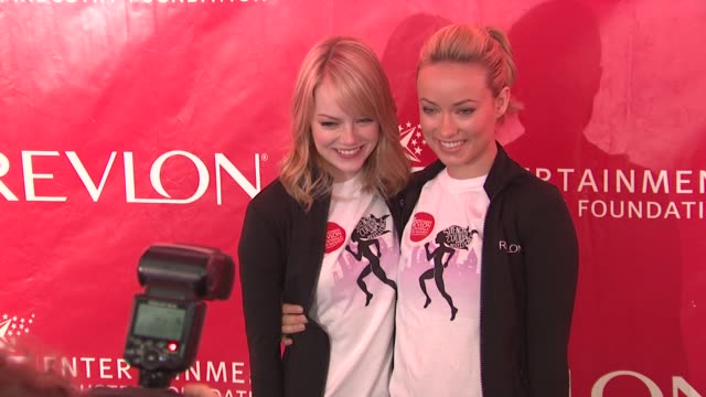 Emma Stone and Olivia Wilde at 15th Annual EIF Revlon Run/Walk For Women at Times Square on May 05 2012 in New York New York
