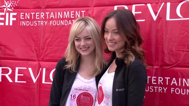 Emma Stone and Olivia Wilde at 16th Annual EIF Revlon Run/Walk For Women at Times Square on May 04 2013 in New York New York