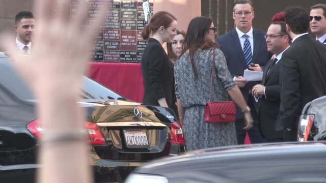 Emma Stone exchanges greetings with fans at the SAG Awards at The Shrine Auditorium in Los Angeles Celebrity Sightings in Los Angeles CA on