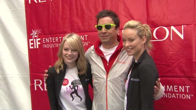 Emma Stone Jimmy Fallon and Olivia Wilde at 15th Annual EIF Revlon Run/Walk For Women at Times Square on May 05 2012 in New York New York