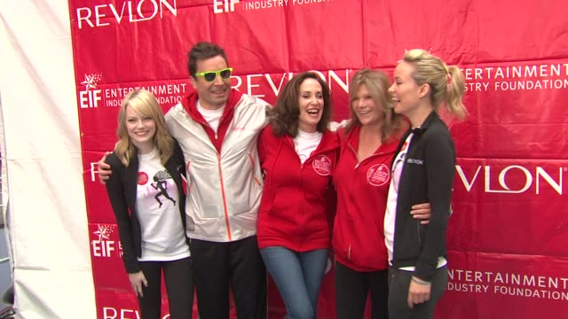 emma stone, jimmy fallon, lilly tartikoff, lisa paulsen and olivia wilde at 15th annual eif revlon run/walk for women at times square on may 05, 2012... - レブロン点の映像素材/bロール