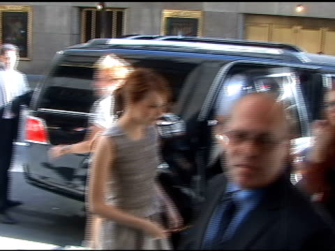 Emma Stone pauses for a moment as she arrives at 'Access Hollywood' in New York 08/11/11