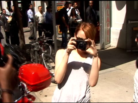Emma Stone turns the tables on the paparazzi as she leaves Japonica Restaurant in Grenwich Village in New York 08/11/11