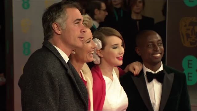 emma thompson and family pose for photographers at the baftas 2014 - 2014 stock videos & royalty-free footage