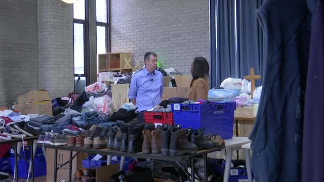 emma thompson raises awareness of tb int setup shots of reporter and dr al story in clothes distribution centre dr al story interview sot tb can... - emma thompson stock videos and b-roll footage